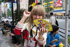 A girl dressed up handing out fliers