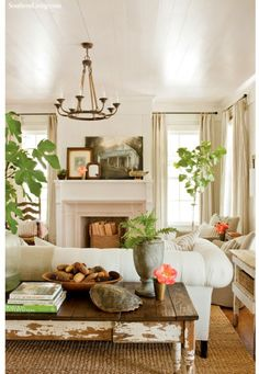 Creamy white/eclectic living room with traditional and cottage elements. Incorporate color & fill the room w/ plants