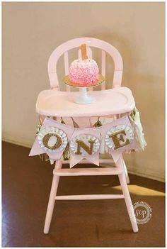 Decorated high chair and smash cake at a pink and gold star birthday party! See more party ideas at CatchMyParty.com!