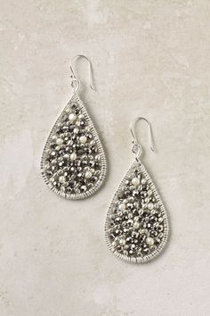 silver sparkly earrings from anthropologie....i think i need to get these. love the detail!