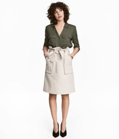 Light beige. Cargo skirt in woven cotton-blend fabric with patch front pockets, wide tie belt at waist, zip fly, and hook-and-eye fastener.