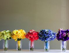 """""""Your bridesmaids don't have to hold the same kind of flowers to look the part. Have each one carry a bouquet in a signature color or let your florist create several mono-botanic bouquets in the same hue. Or add fancy ribbon wrappings to help each girl stand out."""" Photo: Embrace Life Photography Via TheKnot"""