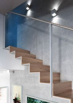 Oblique design steel and wooden staircase in Brno