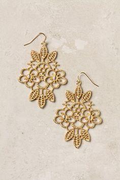 gilded needlework earrings.
