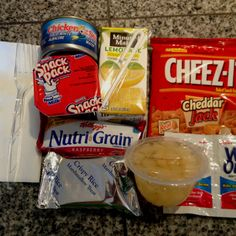 I've been making these food packs for the homeless people I run into.  Just shopping at the QFC, I can make these for under $4 each.  I'm going to see how much better I can do on price by shopping at Costco.  Contents: Tuna fish, crackers, cereal/granola bar, fruit cup, pudding, rice crispy treat, juice box, fork, napkin, wet wipes.