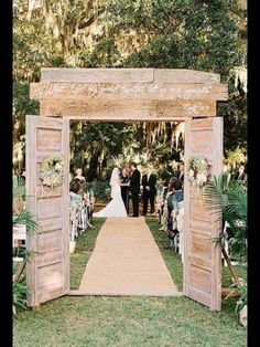 Gorgeous entrance for an outdoor garden wedding
