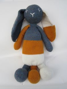 Knitted rabbit with three legs