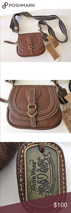 "Nine West Brown Saddle Crossbody Purse Handbag From the Nine West Vintage America collection.  Brand new with tags.  Man made materials.  Beautiful brown saddle color with woven strap.  Measures about 7"" long and 6"" high. Nine West Bags Crossbody Bags"