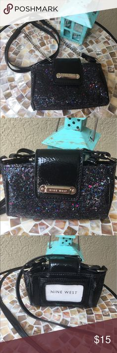 """🆕Nine West Funfetti glitter crossbody Sparkle and shine with this black and funfetti glitter crossbody by Nine West! Handle drop is 24"""" but could be removed if you'd rather carry or use as a wallet in another bag! Snap front closure has three compartments- one in middle is a zipper closer. Never been used ! There is also a clear ID slot on back!  ✅I ship same or next day ✅Bundle for discount Nine West Bags Crossbody Bags"""
