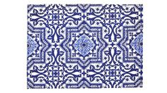 A cotton placemat printed with a blue-and-white pattern that evokes tilework