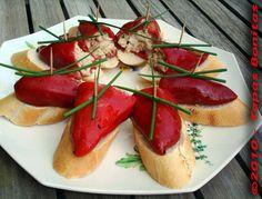 """White Tuna in Piquillo Pepper  """"Pimiento del Piquillo Relleno""""  http://www.tapasbonitas.com/tapas_pan_bonito/Tapas_Pan_Piquillo_Bonito_01.php"""