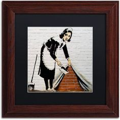 Trademark Fine Art Maid Canvas Art by Banksy, Black Matte, Wood Frame, Size: 16 x 16, Multicolor