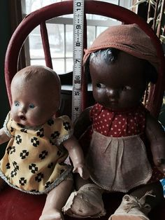 "Unmarked early composite white and black americana. Two baby listing wearing original and/or vintage clothing. ""Topsy"""