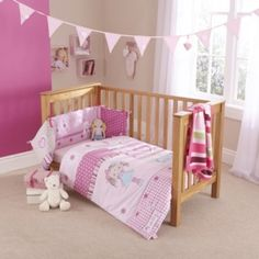 Clair de Lune My Dolly Pink Cot Bedding. Cute character quilt and bumper set in shades of pink, featuring a rag doll, gingham and polka-dots for a fun nursery theme. Great for a little girl, head to the website to get yours.