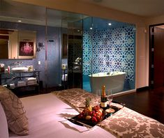 Andaz San Diego    The Shower: At the touch of a button, a glass partition that separates the 1,275-foot Star Suite from a humongous shower turns clear or opaque, connecting the showering experience with the rest of the bedroom.