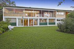 Two-storied midcentury modern home with expansive lawn