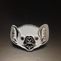 Image of Bat face enamel pin