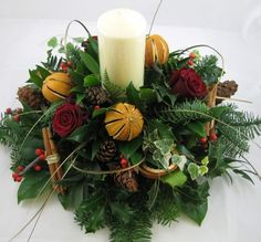 Christmas Table design - candle and dried oranges - Elizabeths the florist Christmas Flowers, Christmas Makes, Rustic Christmas, Christmas Crafts, Candle Arrangements, Christmas Flower Arrangements, Centrepieces, Christmas Candle Decorations, Xmas Wreaths