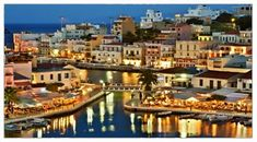 Agios Nikolaos, Crete on the north west of the Mirabello Bay and is the capital of Lassithi. It has many attractions including the beautiful and scenic Lake Voulismeni, a small lagoon in the city center, this small park with pine trees above the lake, the Marina City Square, Nearchus, the Municipal Gallery, Kitroplatia a small square with a of the most popular city beaches and islands Saints and Lighthouse.