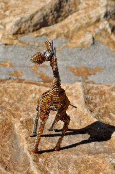 Brown beaded giraffe African wire sculpture by akwaabaAfrica, $16.00Use this handcrafted giraffe to bring African life to a garden or any ornamental display in the office or home. African Life, Everyday Items, Beads And Wire, Wire Art, Giraffe, Display, Sculpture, Trending Outfits, Brown