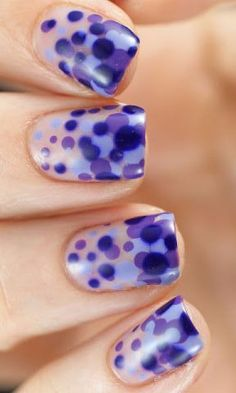 Polka dots are always a fave for spring fashion, but there's something totally unique about this bold manicure that layers dots in several shades of purple, creating an almost bubbly, 3D effect.