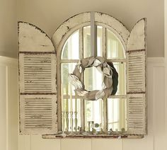 """Arched Door Mirror  $399.00    A vintage window frame inspired this piece, which is distressed and textured by hand for a timeworn look.    55"""" wide x 46"""" high   Crafted of poplar wood with a distressed painted finish.   Shutters open and close.       Saw it in the store , a little bit over the top in bath room"""