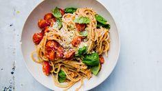 Basil is a mere garnish in this nutty, cheesy, peak-season walnut tomato pesto sauce.