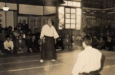 "Aikido Founder Morihei Ueshiba at a demonstration in 1955 given at the end of a special week long training session for the pre and post war Aikido Shihan - the only gathering of its kind to ever occur. There's a little bit about this training session in ""Talking to Tsuneo Ando Part 1 – the Gozo Shioda that Nobody Knew"" on the Aikido Sangenkai blog:  http://www.aikidosangenkai.org/blog/tsuneo-ando-part-1/"