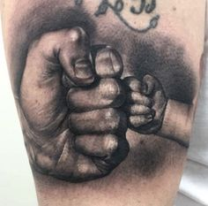 Father and son tattoo by Luis. Limited availability at Redemption Tattoo Studio.