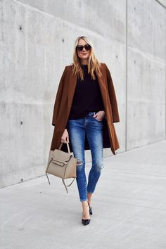 Fall Outfit, Winter Outfit, Tan Topcoat, Black Sweater, Denim Ripped Skinny Jeans, Celine Tie Belt Bag, Black Louboutin Pumps