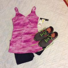 """UA workout top Pink and fuchsia blend. Fitted style. Asymmetrical lines in front. Bra-like straps. Removable bra pads. 16 1/2"""" in length. Under Armour Tops Tank Tops"""