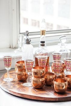 """Sneak Peek: An Eclectic Philadelphia Loft. """"Quoc collects barware – these are some if his favorite copper glasses from antique store in Carlisle, Pa. The carved wood tray is my grandmother's that she brought back from a trip to Brazil."""" #sneakpeek"""
