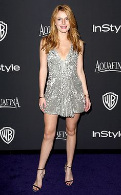 Bella Thorne For the InStyle and Warner Bros afterparty, the Disney star played up her legs in a Giorgio Armani silver sleeveless dress with a pleated neckline.