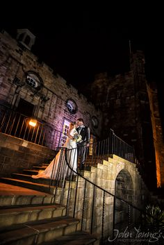 Emma & JJ pose at night in front of Lumley Castle