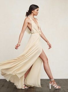 Do unto your bridesmaids as you would want done unto you. The Arianna Dress is just a beautiful gown they can feel good in and most importantly, wear again. This is a full length georgette wrap dress with a ruffled plunging neckline, tied waist and a deep V back. The skirt is full so there's a bit of leg room too. Treat your friends right. Please note, this fabric runs sheer. Made from 100% viscose.