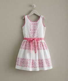 girls candy lace dress - For a sweet look at a special event, choose this cheery dress for your girl. With its symmetrical overlay and bow-topped keyhole cutout in back, it's the perfect blend of lace and charm. An attached pettiskirt adds a touch of fullness.