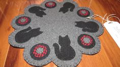 Felted wool Penny Rug Candle Mat designed for by TheStitcheryNiche