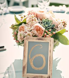 chalkboard table number centerpieces #tablenumbers #chalkboard #peonies #wedding #florals http://theflowerhouse.com/