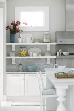 Walker Zanger's Classic White Petite Brick Field from the Tribeca Collection makes a nifty back splash! http://www.traditionalhome.com/images/img_newhousenewkitchen_p2.jpg