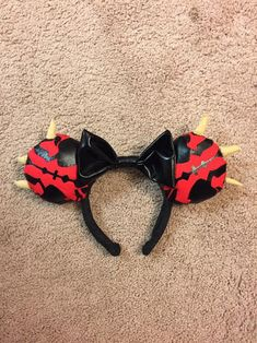 Custom Disney ears that will be sure to make you the talk of the park! Are you a Star Wars Fan? Was Darth Maul your favorite Sith Lord? Youve come to the right place! These Darth Maul ears feature the villains signature black markings made of heat-bonded and hand-stitched vinyl, tan