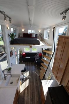 Chinook Peak by Tiny Mountain Houses - Tiny Living A sweeping ladder leads up to the first bedroom loft and a roll-away ladder leads up to the second loft. Tiny House Loft, Modern Tiny House, Tiny House Living, Tiny House Plans, Tiny House Design, Tiny Loft, Small Living, Modern Living, Living Room