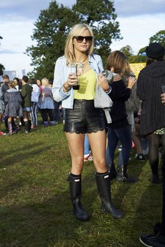Festival-ready with wellies and leather look shorts  #streetstyle at 50th Festival