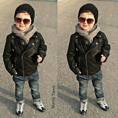 Fitted jeans with a motorcycle jacket accesorized with sunglasses, sneakers, a scarf, and a beanie.