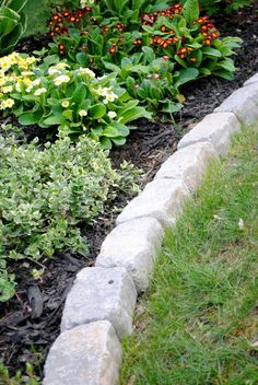 Most people struggle with perfect garden borders but this idea is the perfect border for your beds defining a gardens edge with inexpensive stone that fit garden edginggarden workwithnaturefo