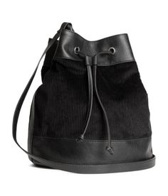 Check this out! Bag in corduroy and imitation leather with a drawstring at top. Adjustable shoulder strap with braided holders. Lined. Size 9 1/2 x 11 1/2 in. - Visit hm.com to see more.