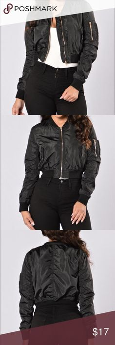 Black Bomber Jacket Super cute cropped bomber jacket from Fashion Nova with hold accents (zippers and buttons). Non-padded, so it's the perfect light weight jacket for fall. 100% polyester. Pairs perfectly with camo mini skirt (also on my page) or distressed denim. Never worn! Fashion Nova Jackets & Coats Utility Jackets