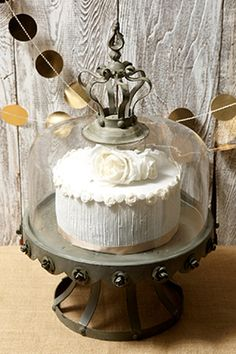 79.99 SALE PRICE! Display your cakes with unparalleled grandeur using this Covered Cake Stand. This metal cake plate features a glass dome with a decorative ...