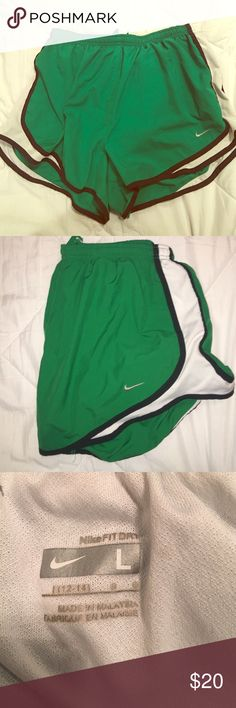 Nike dry tempo shorts Green and white Nike shorts! My name is written on the inside by the tag (I didn't post picture because don't want people knowing my last name). Other than that they are in top top condition! Green isn't my color, but it could be yours! Nike Shorts