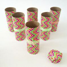 Make a cute bowling game with the kids using recycled cardboard tubes and Duck tape - easy craft and fun activity! Tutorial included.