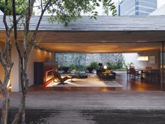 By keeping the front and back gardens at the same elevation as the living area, architect Marcio Kogan created one giant living space.